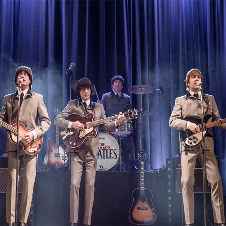 The Cavern Beatles performing a show