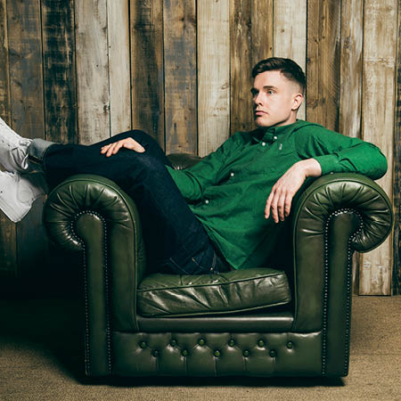 Image of Ed Gamble on a sofa