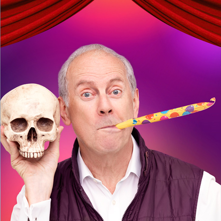 Gyles Brandreth performing at a show