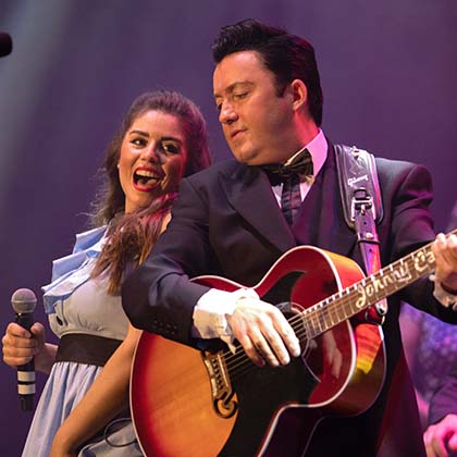 Clive John performing as Johnny Cash and his Wife June Carter played by Emily Heighway in the performance of the Johnny Cash Roadshow