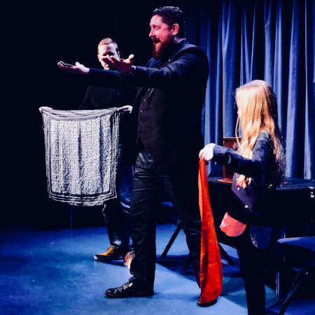 Performer from The Real Magic Show on stage