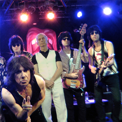 Members of The Counterfeit Stones on stage