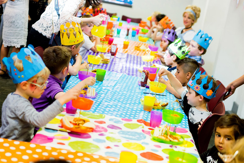 Image of childrens party having food
