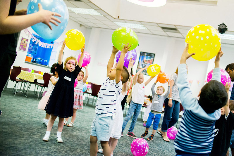 Image of children playing with balloons at a party