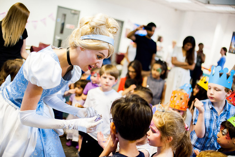 Image of a character entertainer interacting with children at a party