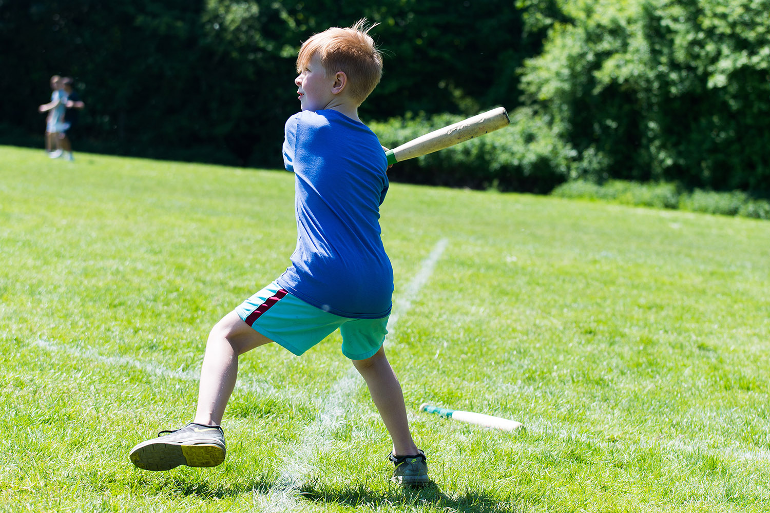 Image of child playing rounders at a outdoor party